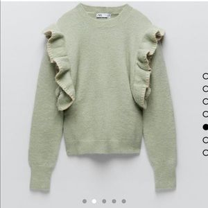 Wool knit sweater with ruffled shoulders